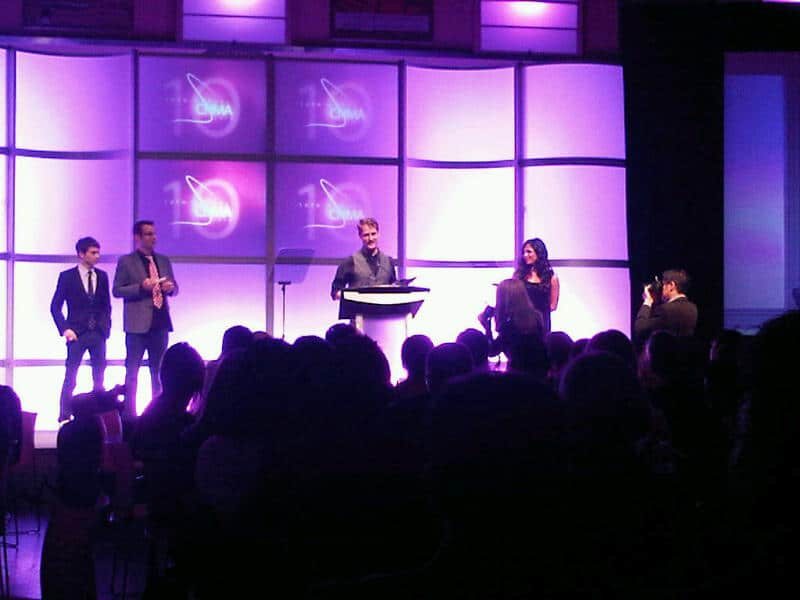 CEO Ryan Holmes receiving award from CNMA
