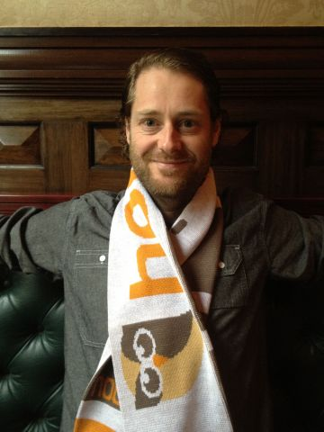 Ryan Holmes models the HootSuite soccer scarf