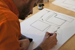 Freemium infographic, Jason drawing at desk