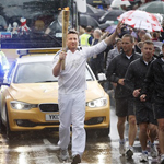 TV Chef and Torchbearer Jamie Oliver carries the Olympic Flame on the Torch Relay journey between Newport and Saffron Walden.