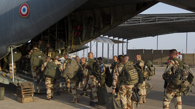 French soldiers of the 21st Marine Infantry Regiment board a plane to Bamako, the capital from Mali, at the N'Djamena's airport, in Chad.