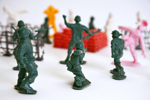 Close-up of toy infantry soldiers recreating a battle scene