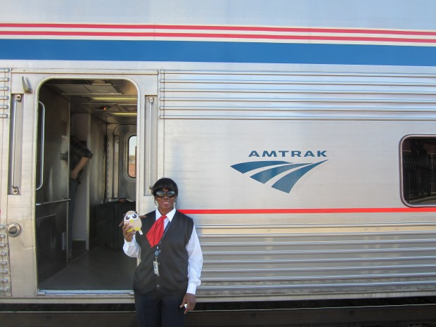 Sheena from Amtrak poses with Owly in Tucson, AZ