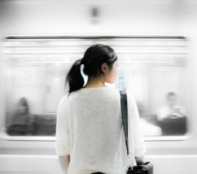 woman standing in subway station