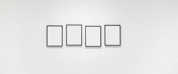 4 blank pictures on blank wall