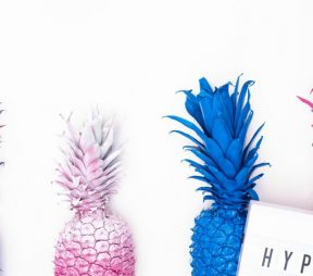 "colorful pineapples with the word ""hype"""