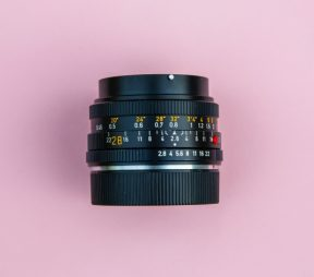 Camera lens on a pink background