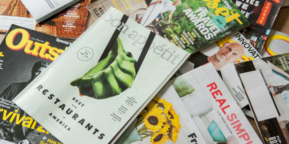 Pile of magazine advertisements