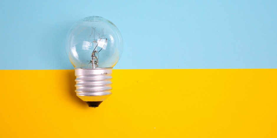 lightbulb on blue and yellow background