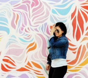 woman posing against art wall