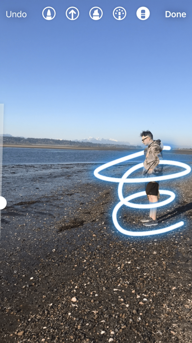 eraser tool effects on person standing on beach