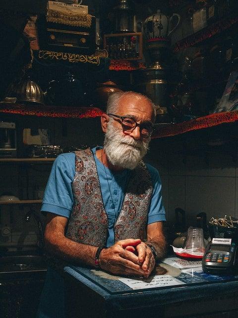 portrait of a male shopkeeper in Tehran