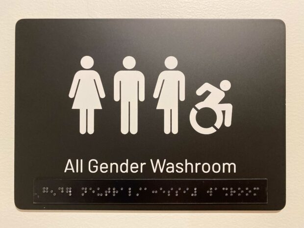 Inclusive washroom sign with braille in the Hootsuite Vancouver office