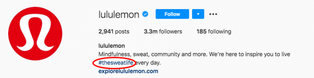 """Lululemon's branded Instagram hashtag """"the sweat life"""" in their bio section"""